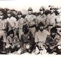 Lee Hak Rae (left) poses with other Korean civilian workers recruited by the Imperial Japanese Army to guard POWs forced to build the Thai-Burma railway in Thailand in 1942. | PHOTO COURTESY OF THE HISTORY MUSEUM OF J-KOREANS