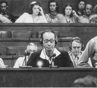 Hajime Satomi, who headed an opium-dealing operation in China during the war that bankrolled the Japanese military and puppet governments in China, testifies during the Tokyo war crimes tribunal on Sept. 4, 1946. | KYODO PHOTO