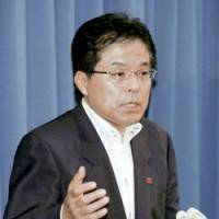 Internal affairs minister Hiroya Masuda speaks to reporters in Tokyo on Saturday. | KYODO PHOTO