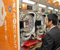 A man plays pachinko at one of P-Ark Holdings' parlors in Tokyo's Ginza district last week. | YOSHIAKI MIURA PHOTO