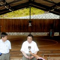 Sumo stable master Tokitsukaze fields questions from reporters June 28, two days after the death of wrestler Takashi Saito.   KYODO PHOTO