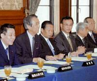 Liberal Democratic Party executives attend an LDP General Council meeting convened Wednesday at the Diet building to approve a special antiterrorism bill. | KYODO PHOTO