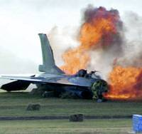Flames engulf an Air Self-Defense Force F-2 fighter after it crashed on takeoff Wednesday morning at Nagoya airport, injuring its two pilots. | CHUBU NIPPON BROADCASTING/KYODO PHOTO
