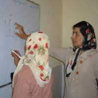An Afghan woman teaches another woman math in a class sponsored by Nippon International Cooperation for Community Development. | PHOTO COURTESY OF NICCO