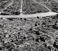 An aerial photo taken in 1945 shows the industrial section along the Sumida River in Tokyo destroyed by U.S. bombing raids. | AP FILE PHOTO