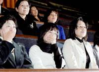 Plaintiffs WHO were infected with hepatitis C from tainted blood products are overcome with emotion Friday while watching the Upper House pass a bill to provide relief measures for such cases. | KYODO PHOTO