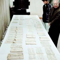 Documents from the 18th century explaining how delegations from the shogunate should be handled are shown to reporters in Chizu, Tottori Prefecture. | KYODO PHOTO