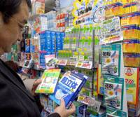 A man checks out the selection of protective masks at a Matsumotokiyoshi Co. pharmacy in Tokyo's Ginza district in late January as the pollen season draws closer. | YOSHIAKI MIURA PHOTO