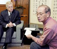 Okinawa Gov. Hirokazu Nakaima receives a letter from U.S. Ambassador to Japan Thomas Schieffer addressed to the teenager allegedly raped by a U.S. Marine and her family during a meeting at the prefectural government office Wednesday. | KYODO PHOTO