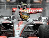 Lewis Hamilton raises his fist in triumph after crossing the finish line at the 2007 Japanese Grand Prix at Fuji Speedway in Oyama last September. | BRIDGESTONE PHOTO / AP