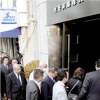Police investigators raid the office of real estate firm Koyojitsugyo on Tuesday morning before arresting the president and nine others on suspicion of pressuring tenants to vacate a building in Tokyo. | KYODO PHOTO