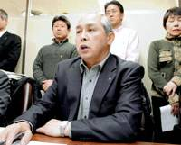 Kazuo Kawabata of the National Railway Workers' Union speaks Thursday in Tokyo about the Tokyo District Court ruling rejecting their lawsuit over their failure to be rehired. | KYODO PHOTO