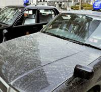 Spring cleaning: A taxi in Fukuoka is covered with yellow dust from China last month. | KYODO