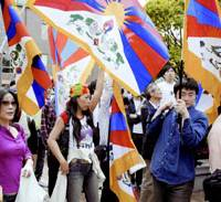 Refusing to be silenced: Protesters holding Tibet flags stage a rally Thursday at Waseda University in Tokyo ahead of Chinese President Hu Jintao's speech at the campus later in the day. | KYODO PHOTO