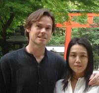 Common ground: Ted Taylor and Miki Matsumoto pose in front of Shimogamo Shrine in Kyoto. Common interests in yoga and shiatsu brought the two together in Kyoto, where they enjoy the ancient capital's many green parks, temples and shrines. | COURTESY OF TED TAYLOR PHOTO