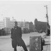 Starting out: Donald Richie poses in Tokyo's Nihonbashi district in 1947, the year he arrived in Japan. | COURTESY OF DONALD RICHIE