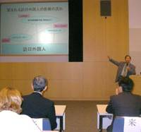 Talk therapy: Toshimasa Nishiyama, a professor at Kansai Medical University, discusses ways to improve medical services for foreign visitors to Japan at a symposium in Tokyo on May 31. | AKEMI NAKAMURA PHOTO