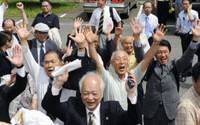 Victory at sea: Fishermen and their supporters erupt with joy Friday outside the Saga District Court after the government was ordered to open the floodgates of the Isahaya Bay dike in Nagasaki Prefecture. | KYODO PHOTO