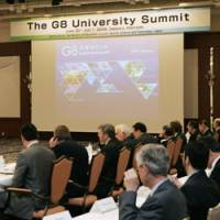 Theoretical groundwork: Officials from 34 universities in 14 countries discuss the G8 summit in Sapporo on Monday. | KYODO PHOTO