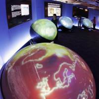 Sphere pressure: Digital globes depicting global warming and other problems on Earth are displayed at the international media center in Rusutsu, Hokkaido, ahead of next week's Group of Eight summit. | KYODO PHOTO