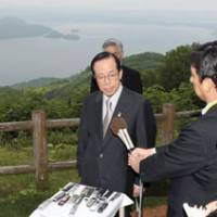 Full belly: Prime Minister Yasuo Fukuda speaks to reporters after the Group of Eight luncheon Tuesday at the Windsor Hotel Toya overlooking Lake Toya in Hokkaido. | KYODO PHOTO