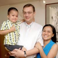 Happy together: Marc Van Cauteren and Reiko Shinozaki pose with their son, Arno, at their house in Meguro Ward, Tokyo, in June. | YOSHIAKI MIURA PHOTO