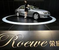 Rover returns: Models stand next to the Shanghai Automotive Industry Corp's Roewe at the China Industry Fair in 2006 in Shanghai. When MG Rover went bust, Chinese automaker SAIC Motor Corp already owned intellectual copyrights to the R 75, 25 and all the engines, enabling them to recreate the Rover as Roewe. | AP PHOTO