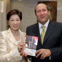 High on Japan: Former Egyptian Ambassador Hisham Badr shows off his new book, 'Sphinx and Japanese Sword,' along with former Defense Minister Yuriko Koike, a Cairo University graduate mentioned in the book, during a reception at the Egyptian Embassy last week. | YOSHIAKI MIURA PHOTO