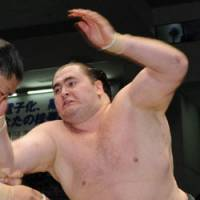 Tossed out: Russian sumo wrestler Wakanoho grapples with an opponent on the last day of the Nagoya Grand Sumo Tournament on July 27. | KYODO PHOTO