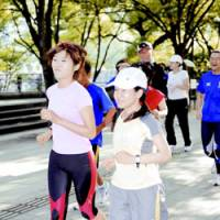 Pace-setters: Young women jog in Osaka as a female running boom spreads nationwide. | KYODO PHOTO