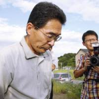 Fearing the worst: Masayuki Ito faces reporters outside his home in Kakegawa, Shizuoka Prefecture, Wednesday before his son, Kazuyuki, was confirmed dead in Afghanistan. | KYODO PHOTO