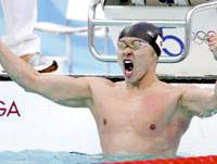 King of the world: Swimmer Kosuke Kitajima shouts after winning gold in the 100-meter breaststroke at the Beijing Olympic Games on Aug. 11. | KYODO PHOTO