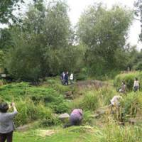 A bit of weeding: Japanese volunteers work on restoring the Garden of Peace at Hammersmith Park in western London. | KYODO PHOTO