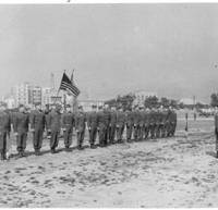 Fall in: U.S. soldiers line up holding an American flag in this undated photo taken in Japan by Elizabeth Ryan, who stayed in Kobe from February 1947 to July 1948. | COURTESY OF KEN ALLEY