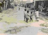 Dependent: Children play in a street in this photo taken by Elizabeth Ryan sometime between February 1947 and July 1948 during the Occupation. | COURTESY OF KEN ALLEY