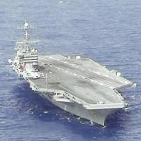 Here come old flattop: The nuclear-powered carrier USS George Washington cruises in an exercise off Florida last year. | KYODO PHOTO