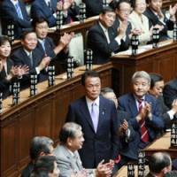 Rising to the occasion: Taro Aso stands to receive applause after the Lower House voted for him to succeed Prime Minister Yasuo Fukuda on Wednesday. | KYODO PHOTO