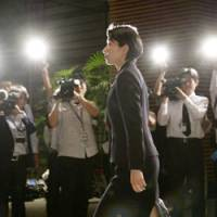 Youngest ever: Lower House member Yuko Obuchi, a daughter of late Prime Minister Keizo Obuchi, walks through the prime minister's office Wednesday before her appointment as minister in charge of population issues. | KYODO PHOTO