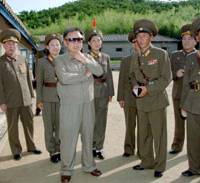 One size fits all: North Korean leader Kim Jong Il visits a military unit at an undisclosed location in this recent photo distributed by North Korean media. | KYODO PHOTO