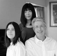 Together again: Rieko and Michael pose with daughter, Kasumi, for a family portrait at their home in Hachioji, Tokyo, on Oct. 4. | COURTESY OF MICHAEL CLAXTON