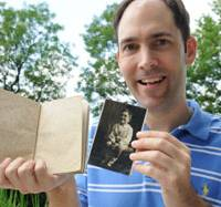 Rediscovering the past: David Moreton holds up the diary and a photo of his grandfather, Albert, during an interview with The Japan Times in Chiyoda Ward, Tokyo, in September. | SATOKO KAWASAKI PHOTO