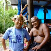 The quiet life: Shuichi Endo (left), photographer and representative of NPO Tuvalu Overview, hangs out with a local resident on Niutao Island in September. | COURTESY OF SHUUICHI ENDOU