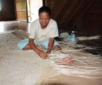 On Borneo, indigenous women earn a pittance weaving rattan for Japan