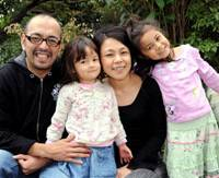 Multinational: Riki and Tomoko Melwani and their daughters, Kiran and Sarina, pose at their home in Ota Ward, Tokyo, in November. | SATOKO KAWASAKI PHOTO