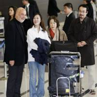 Homecoming: Released aid worker Keiko Akahane (second from left) chats with an official from Doctors of the World after arriving Tuesday at Chubu International Airport in Aichi Prefecture with her mother, Chieko, and older brother, Chihiro. | KYODO PHOTO