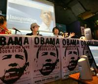 Historic night: Panelists speak late Tuesday before some 100 people gathered at 'Katteni Obama Night,' or 'Our Way to Celebrate Obama Night,' in Shinjuku Ward, Tokyo, to watch the live telecast of Barack Obama's inauguration in Washington. | KYODO PHOTO