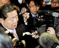 Change of heart: Hidenao Nakagawa, a veteran lawmaker from the Liberal Democratic Party, talks to reporters Thursday after dropping his opposition to a tax reform bill. | KYODO PHOTO