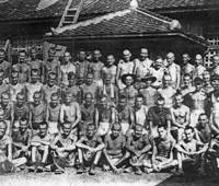Slave laborers: Arthur Gigger (second row, fifth from left) poses in late August 1945 with other Australian POWs who had been put to work at a company run by Prime Minister Taro Aso's family. | COURTESY OF TONY GRIFFITH AND YUKIHISA FUJITA