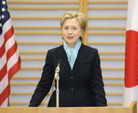 Shifting priorities: U.S. Secretary of State Hillary Rodham Clinton gives a speech at Tokyo's Haneda airport Monday after arriving on her first official overseas trip. | KYODO PHOTO