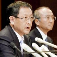 We are family: Akio Toyoda, executive vice president of Toyota Motor Corp., attends a January press briefing during which the carmaker announced his promotion in June to president, replacing Katsuaki Watanabe (right). | KYODO PHOTO